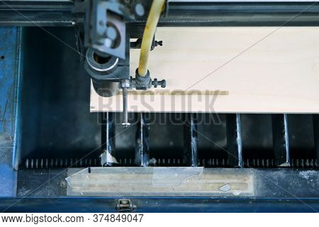 Top View Of The Working Area Of A Laser Engraving Machine While Burning A Picture On A Wooden Workpi