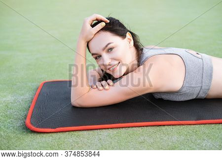 Happy Cheerful Young Sportswoman Finish Productive Training Session, Lying Rubber Mat Pleasant Fatig