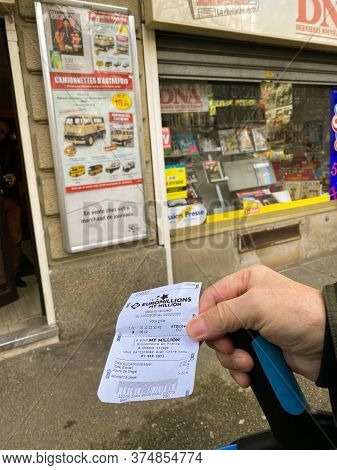 Paris, France - Feb 18, 2020: Senior Male Hand Holding Cane And Lottery Tickets For Lotto And Euromi