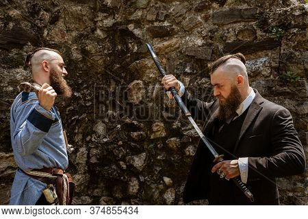 A Man In Viking Clothes Derides His Alter Ego Which Challenges Him By Brandishing A Katana In Contem