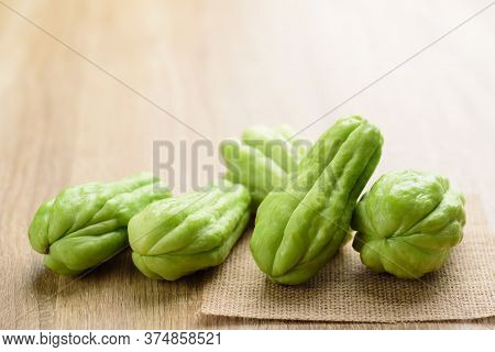 Chayote Squash Or Mirlition Squash On Wooden Background, Organic Vegetable, Edible Plant Fruit