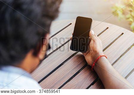 Happy Asian Black Businessman Person Holding A Modern Digital Smart Phone Blank Screen Device Techno