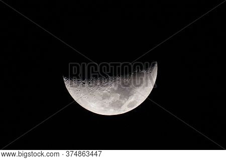 Half Moon, Phase Of The Moon. Highly Detailed Bright Half Moon In The Night Sky, Shrouded In Darknes