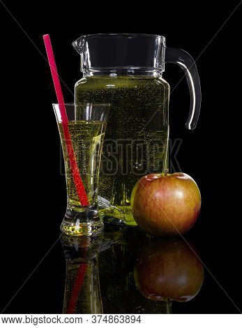 Decanter And A Glass Of Cider, Apple On A Black Background