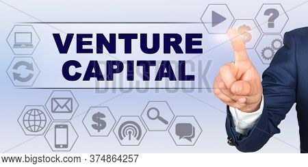 Business Concept. Businessman Touching Virtual Screen With His Finger. Screen Caption - Venture Capi