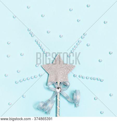 Glowing, Glittering Star On Blue Background With White Beads. Minimal Greeting Card For New Year Or