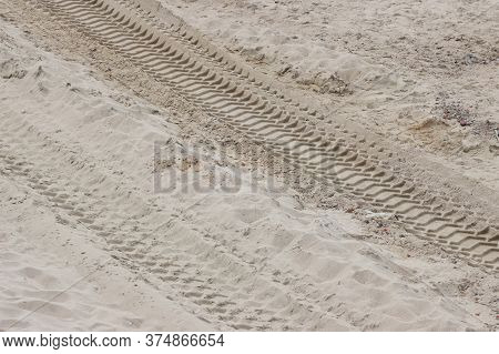 Traces Of Truck Treads On The Sand.