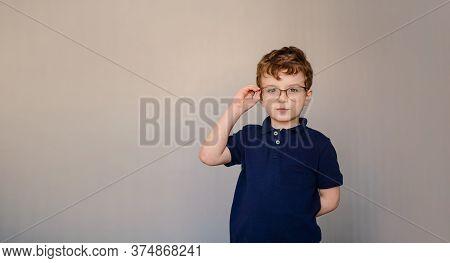 Happy Little Boy Kid In Blue T-shirt Wearing Glasses