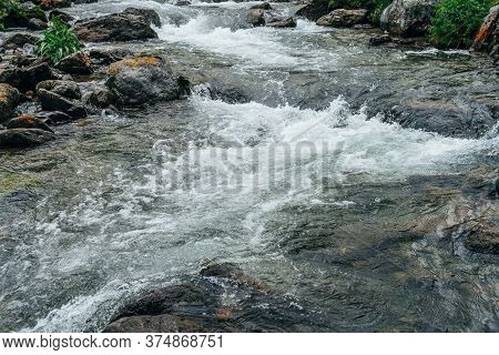 Beautiful Landscape With Stones In Water Riffle Of Mountain River. Powerful Water Stream Among Bould