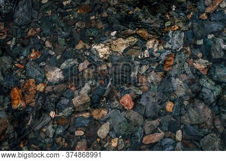 Stones On Bottom Of Mountain Lake With Clear Water. Nature Background With Ripple On Transparent Wat