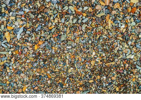 Vivid Nature Background With Many Small Stones Of Different Colors And Shades. Natural Multicolored