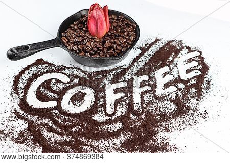 Coffee Text On A White Table With An Ironpan And Coffeebeans