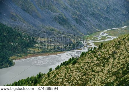 Atmospheric Alpine Scenery With Beautiful Valley With Mountains Lake And Giant Textured Hillside Wit
