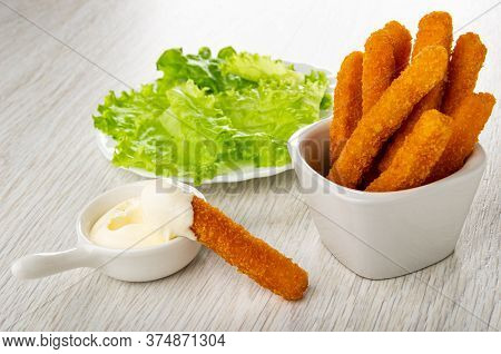 Plate With Leaves Of Lettuce, Chicken Stick In Sauce Boat With Mayonnaise, Few Fried Breaded Chicken