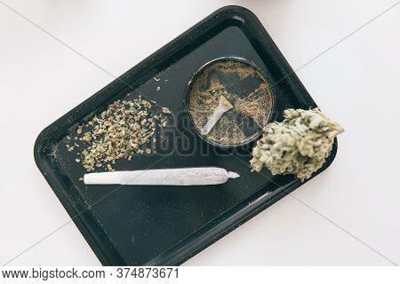 Marijuana Nature Bud Close Up. Grinder And Cannabis Weed Bud. The Pot Leaves On Buds Cbd.