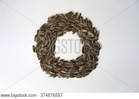 Pile Of Fried Sunflower Seeds With Circle Shape Isolated On White Background.