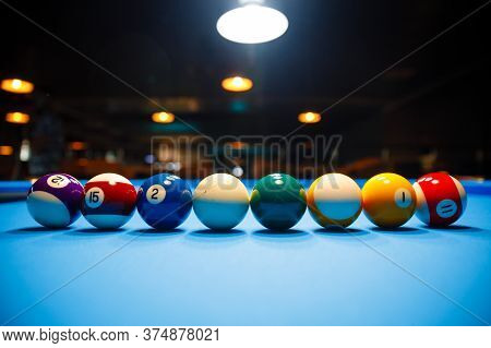 The Game Of American Billiards. Multi-colored Billiard Balls On Gaming Table.