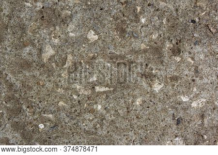 Muddy Concrete Wall With Cracks And Brown Spots. Old And Dirty Tested Wall Background. Old Cracked P