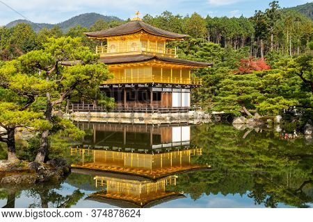Famous Temple Of The Golden Pavilion Building (kinkaku-ji) With Its Reflection In The Pond In A Japa