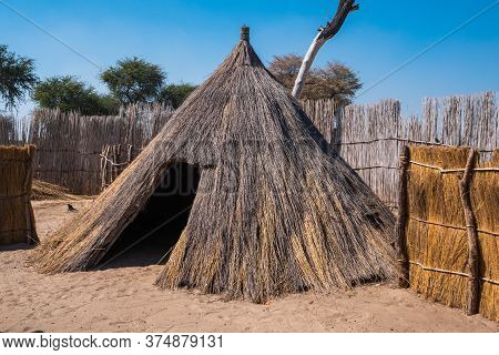 Round Hut Of Mafwe Tribe In Caprivi, Namibia, Africa, A Traditional Primitive Habitation Made Of Ree