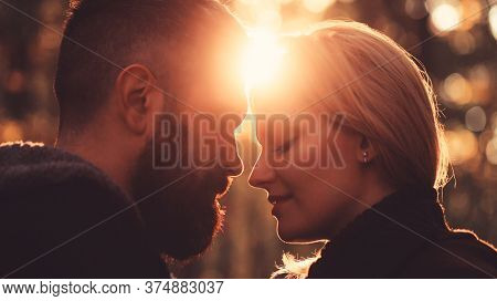 Silhouettes Of A Guy And A Girl On A Sunset Background. Couple In Love. Love Relationship. Couple On