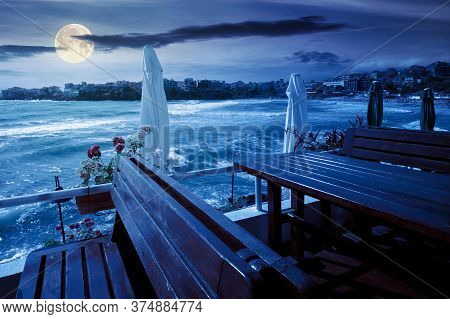 Terrace Of A Restaurant On The Sea At Night. Beautiful View In To The Bay In Full Moon Light. Decora