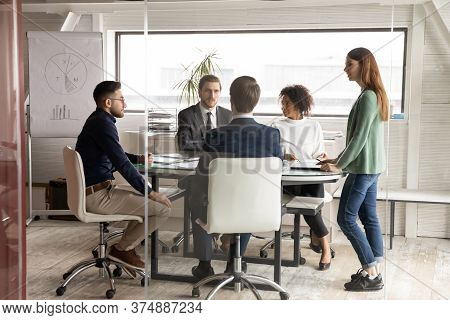 Multiracial Businesspeople Gather In Boardroom Brainstorming Together