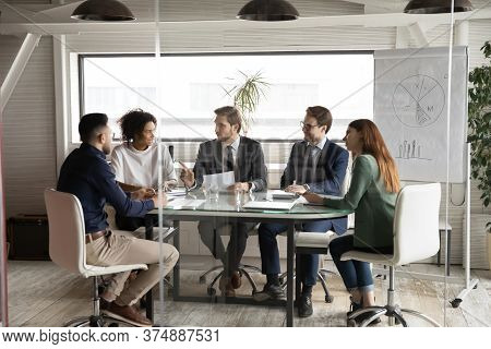 Multiethnic Employees Gather In Boardroom Brainstorming Together