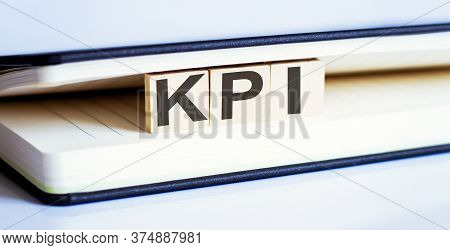 Kpi Word Written In Wooden Blocks, Key Performance Indicator