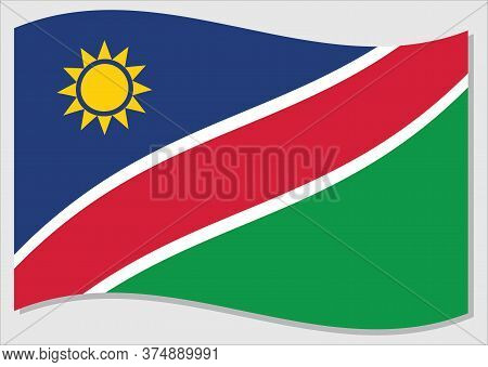 Waving Flag Of Namibia Vector Graphic. Waving Namibian Flag Illustration. Namibia Country Flag Wavin