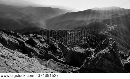 Black And White Mountain With Sunlight Backlit Ray Beams