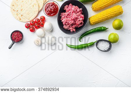 Minced Beef Meat With Raw Ingredients For Tacos With , Corn Tortillas, Chili, Avocado, Over White Ba