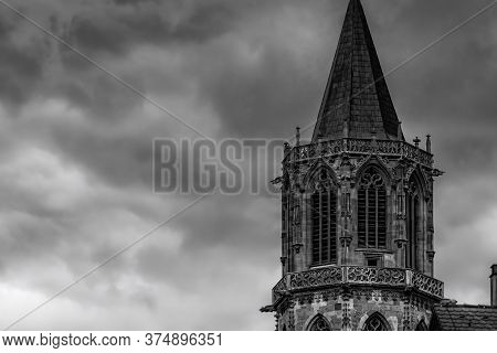 An Old Church Tower In Black And White