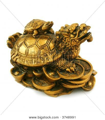 Gold Feng Shui Statuette On A White Background