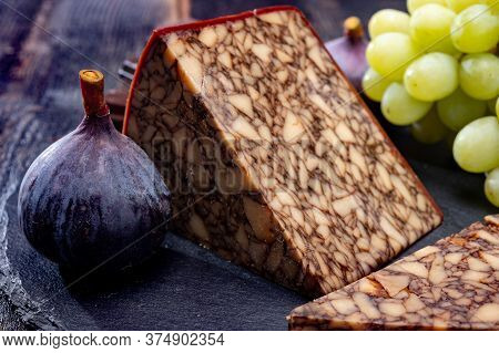 Cheese Collection, Irish Brown Waxed Marbeled Cheddar Cheese Flavoured With Guinness Dark Stout Beer