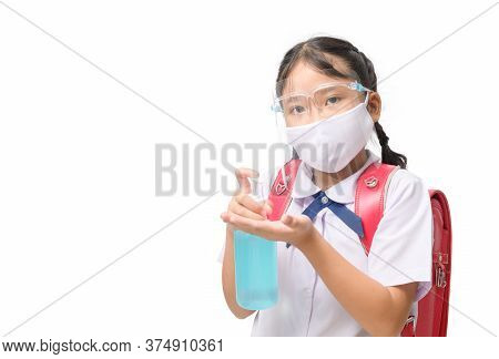 Asian Girl Student Wear Face Shield And Mask Holding Alcohol Gel Bottle Isolated On White Background