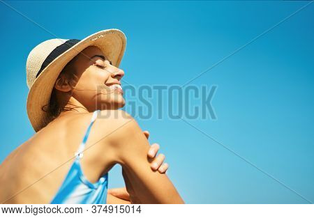 Carefree Relaxed Woman In Hat Enjoying Summer Beach Vacation.