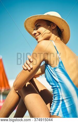 Happy Woman In Straw Hat And Swimsuit Enjoying Beach At Ot Summer Sunny Day.