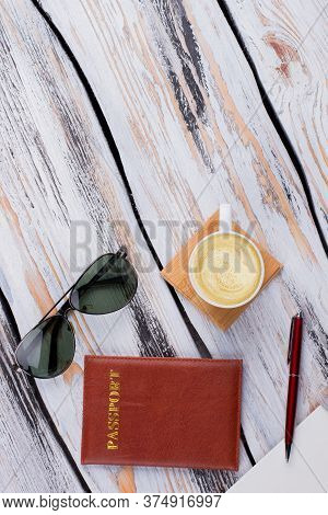 Topview Sunglasses With Cup Of Coffee And Passport. Flat Lay View From Above.
