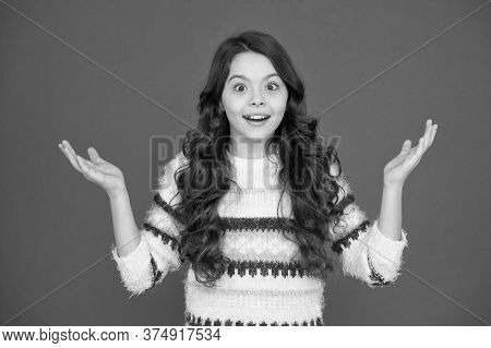 Wonderful. Kid Girl Long Hair Posing Confidently. Girl Curly Hairstyle Feels Confident. Child Psycho