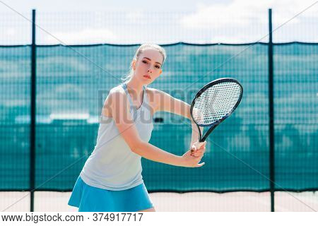Sexy Girl Tennis Player Holding Tennis Racket On The Court. Young Woman Is Playing Tennis.