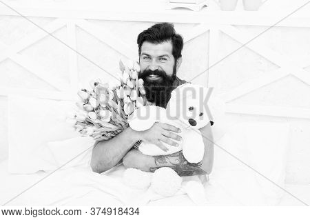 Cute Teddy Bear. Fresh Flowers. Bearded Hipster In Bed. Valentines Day Gift. Birthday Holiday. Man H