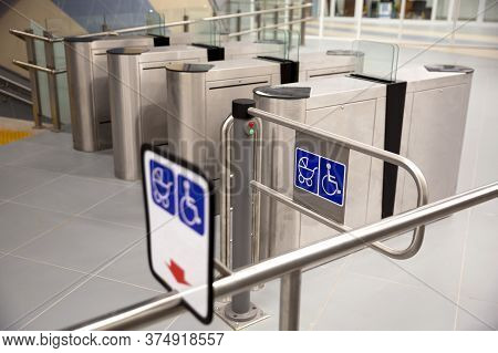 Subway Barriers With Entrance For Physically Disabled People And Women With Baby Strollers.