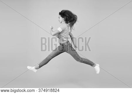 Energy Rush. Energetic Girl In Motion Yellow Background. Sexy Woman In Energetic Movement. Moving Wi