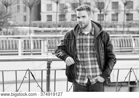 Just Relaxing Here. Man Wearing Leather Jacket. Street Style. Portrait Guy Outdoors. Menswear Concep