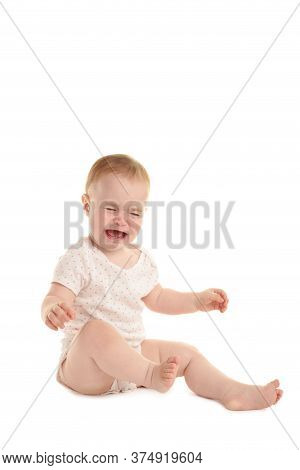 Sad Baby Girl Sitting And Crying Isolated On White Background. Top View