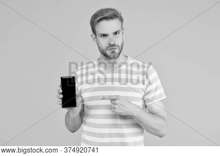 Download And Start Play. Man Pointing At Smartphone. Pointing Gesture. Index Finger Pointing. Pointi