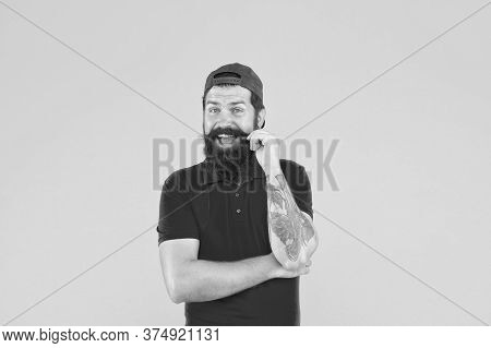 Hipster Cashier. Delivery Service. Restaurant Cafe Staff Wanted. Man Bearded Tattooed Hipster Wear C