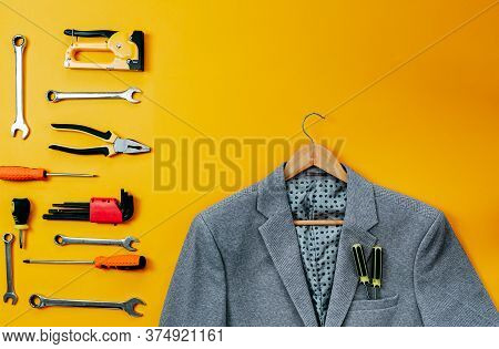 Tools Top View On Yellow Background. Plier, Open Wrenches, Screwdrivers And Staple Gun Flat Lay. Gra