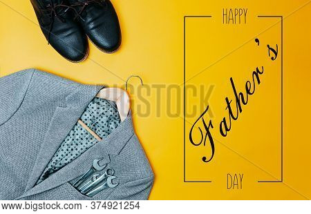 Fathers Day Card With Gray Suit Coat And Open Wrenches From The Pocket. Suit Coat And Brown Leather
